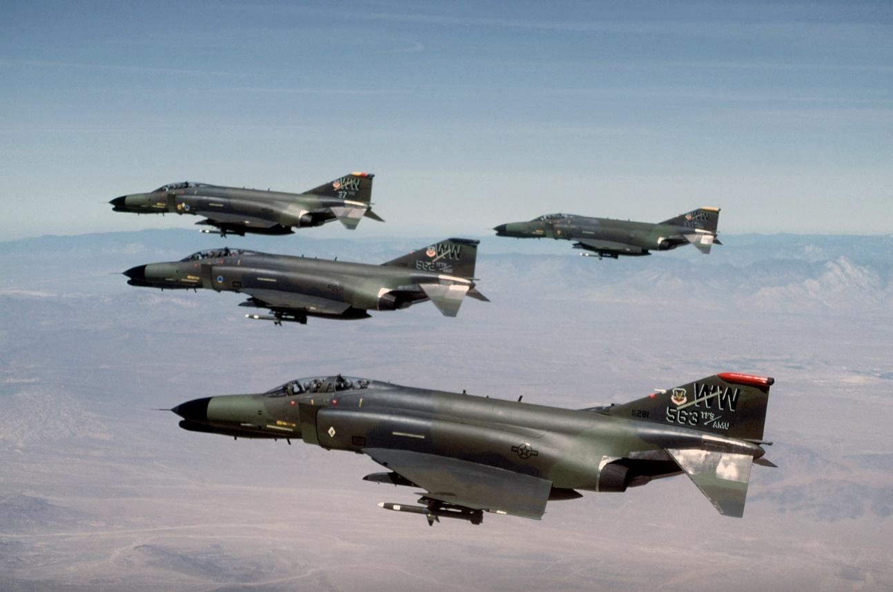 https://cdn10.picryl.com/photo/1986/08/01/air-to-air-left-side-view-of-four-f-4g-phantom-ii-wild-weasel-aircraft-from-7336e8-1600.jpg